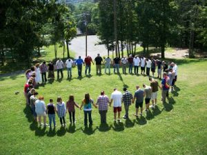 group standing outside at english mountain in large circle