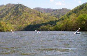 people kayaking on lake