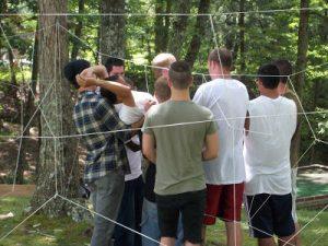 men at English Mountain doing ropes course