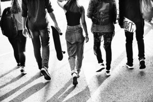 black and white image of group of teens walking