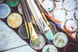 paint brushes and paint for art