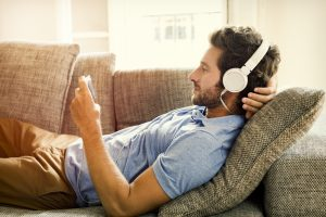 man relaxing listening to headphones
