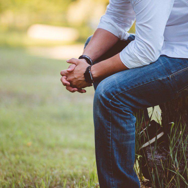 man sitting and thinking
