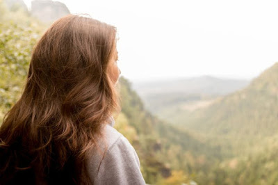 woman gazing at mountain landscape