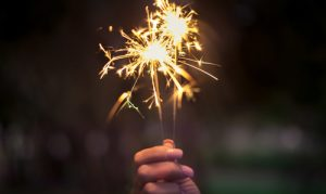 hand holding sparklers