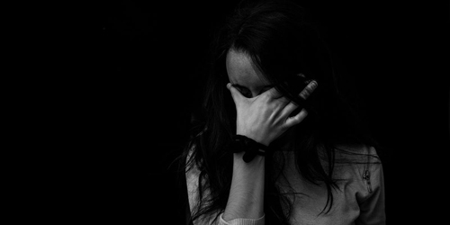 black and white image of sad woman