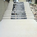stairs outside of building with 12 Steps plaques on them - English Mountain Recovery