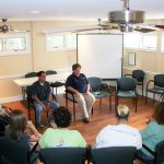 several people sitting in circle - group therapy - English Mountain Recovery