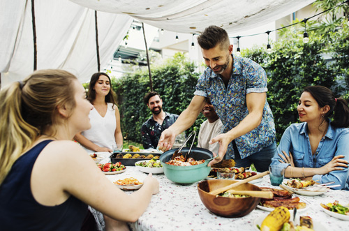 friends having brightly colored dinner outside during the summer - sober summer