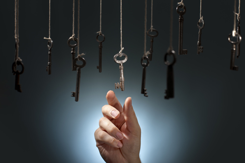 hand reaching for one key out of many keys - 12-step programs