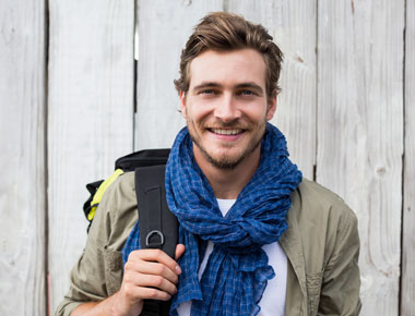 smiling young man with blue scarf - Men's Program at English Mountain Recovery Center - tennessee drug and alcohol rehab center - addiction treatment for men