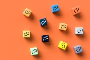 colorful cubes with conversation bubbles on them lying on a bright orange background - drug use