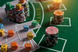 poker table with cards, chips, and dice - substitute addiction